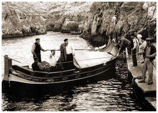 An old photo of fishermen at work at Wied iż-Żurrieq
