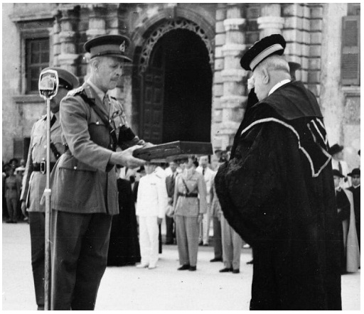 Governor General and Commander-in-Chief in Malta, Field Marshal John Gort, VC, presents the George Cross to Sir George Borg, the Maltese Chief Justice and President of the Court of Appeal, who received it on behalf of the people of Malta in the ruins of Palace Square, Valletta, in September 1942.
