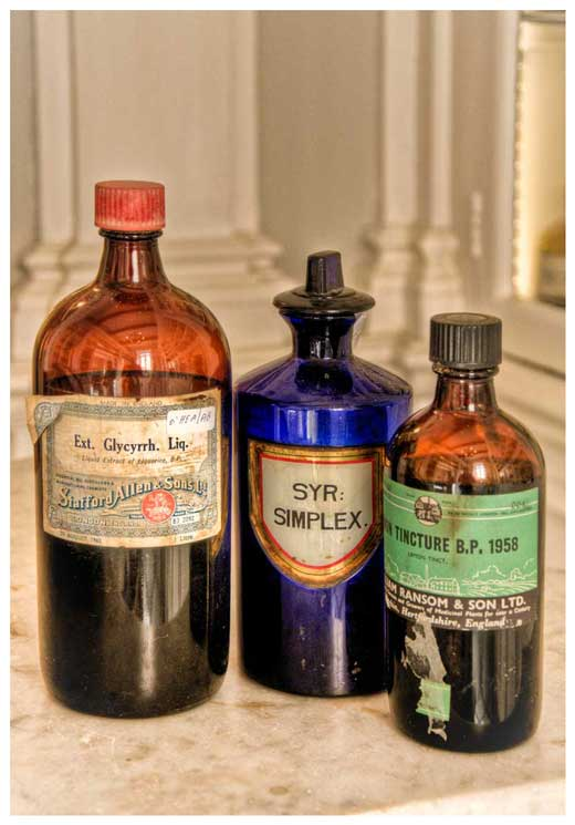 Various chemicals in their original manufacturer's containers displayed in the Santo Spirito Pharmacy.